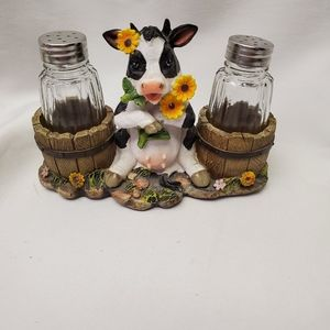 Salt and pepper shakers and holder